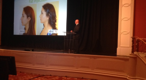 """Me giving my presentation on """"The Perfect Nose: Creating Balance and Proportion in Rhinoplasty."""""""